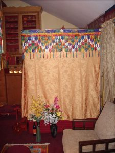 sand mandala inside the gold curtain
