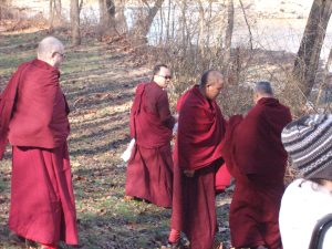 Lamas and monks on the way to the river