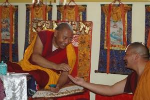 Khenchen Rinpoche, Konchog Gyaltsen giving a precious pill to Drupon
