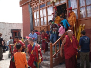 Monks at Phyang Gompa, completing sand mandala dissolution