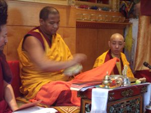 Khenpo Tsultrim starting to offer a mandala