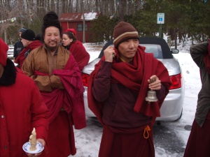 Tibetan lamas outside the TMC, following mani drupchen